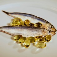 photo of fresh fish + vitamin e capsules