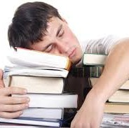 photo, man sleeping on stack of books